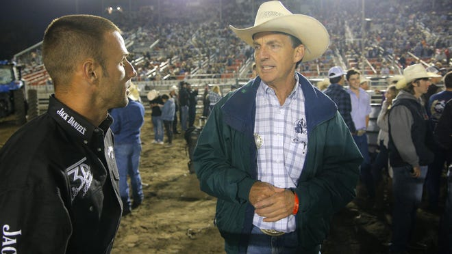 Dr. Bert Tardieu checks up on bull rider Billy Robinson during the 2015 Professional Bull Riding BlueDEF Velocity Tour Event on Wednesday at the Salinas Sports Complex.