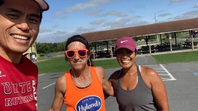 Chambersburg's Laurie Dymond, flanked by Dr. Stephen Bui of Waynesboro and Anna Jones of Chambersburg, completed her Virtual Boston Marathon at Norlo Park in 3:25:22.