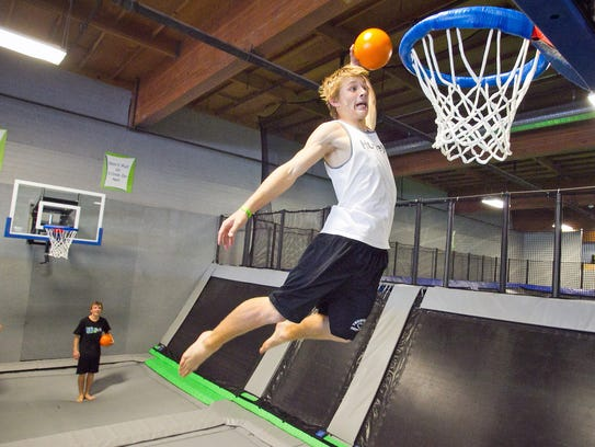 Scott Beaudoin, 17, bounces on a trampoline and dunks