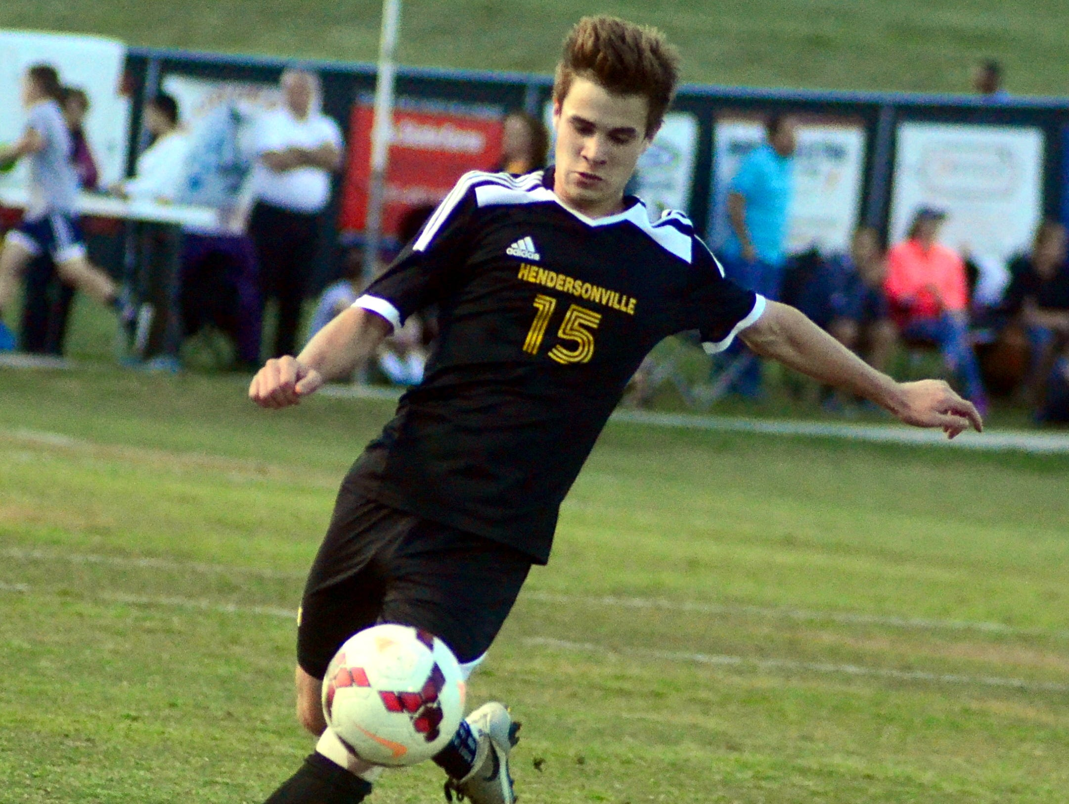 Hendersonville High senior Alex Bragg clears the ball out of his own end during first-half action.
