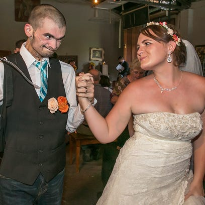 Newlyweds Chris and Nicole Ford dance down the aisle