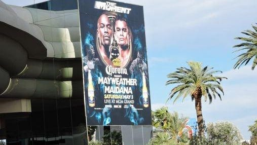 A mural adveretising the Floyd Mayweather fight against Marcos Maidana on May 3 hangs from the side of the MGM Grand that faces the strip in Las Vegas.