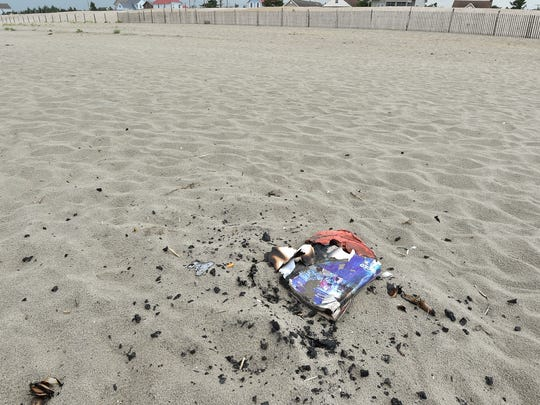 Remnants Of A Beach Fire On The Sand At Broadkill