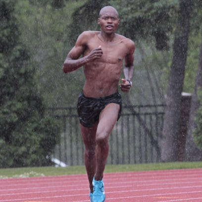 Kip Tisia, the area's top distance runner, gets in