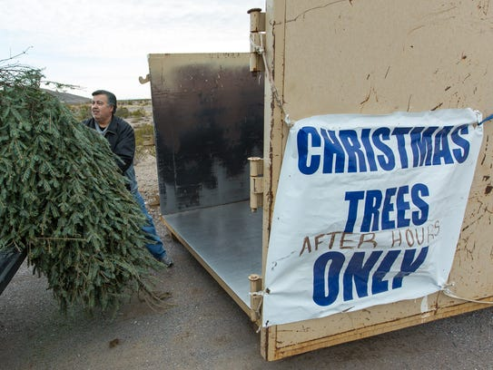Archie Martinez, of Las Cruces, recycles his Christmas