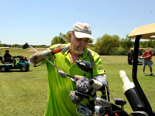 Steve Gandy, from Van, puts one of his clubs into his