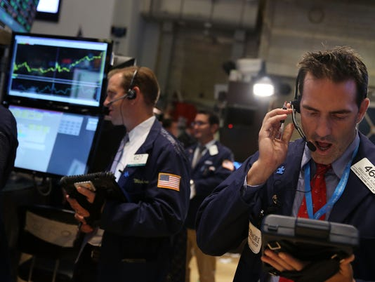 Stocks finish mixed as Apple shares sink again