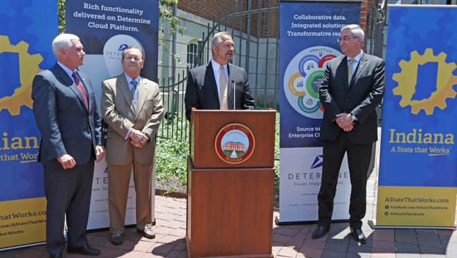 Left to right, Indiana Governor Mike Pence, Carmel City County Council At Large, Ron Carter, Determine Inc. President and CEO Patrick Stakenas, and Indiana Lieutenant Governor Eric Holcomb, announce the relocation of Determine Inc.'s headquarters from Silicon Valley to Carmel, Monday June 13th, 2016.