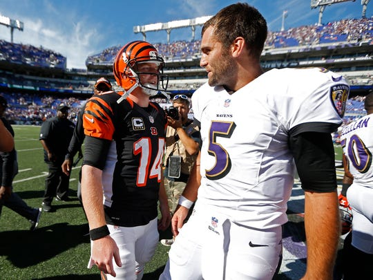 Bengals quarterback Andy Dalton and Ravens quarterback Joe Flacco chat after Sunday's game in Baltimore.