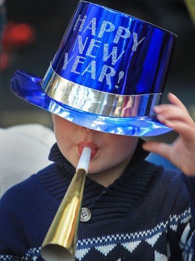 """Ty Olesen, 4, brings in the new year at the Children's Museum of Indianapolis annual New Year's Eve celebration, """"Countdown to Noon,"""" Tuesday, December 31, 2013."""