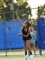 Taylor Tarrolly plays doubles at the Tigers' doubles tournament on Aug 29 at South Junior High.