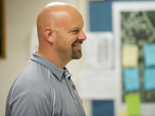 Jon Carl laughs with a student during his U.S history class at Reitz High School.