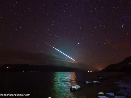 Stunning photo of shooting star over Loch Ness