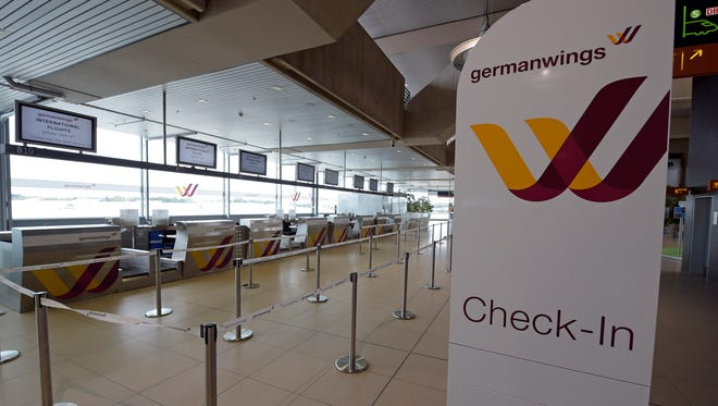 A file photo shows the counters of German airline Germanwings at the airport in Cologne, Germany, on Oct. 16, 2014.