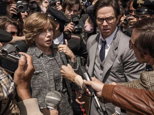 """Michelle Williams, left, and Mark Wahlberg in a scene from """"All the Money in the World."""""""