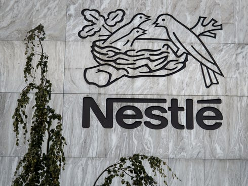 A sign of the world's biggest food company Nestle is seen at their headquarters in Vevey.