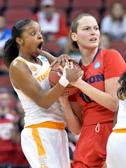 Tennessee's Diamond DeShields, left, reacts to a foul called against her as she battled Dayton's Andrijana Cvitkovic for a loose ball on Saturday in Louisville, Ky.