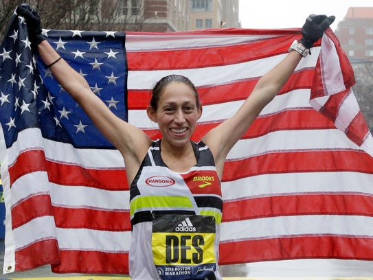 Desiree Linden celebrates after winning the women's