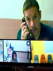 "Anthony Michael Getchius, 43, of Newark and Noelle Marie Smart, 48, of Jersey City, are shown on a video link from the Ocean County Jail Wednesday, May 23, 2018, during their detention hearing.  They were each charged with lewdness for their alleged copulation in the ""sacred area"" adjacent to Our Lady of Perpetual Help Catholic Church in Seaside Heights.  The lovers were caught having sex by a priest beneath a statue of the Virgin Mary the church on Tuesday afternoon."