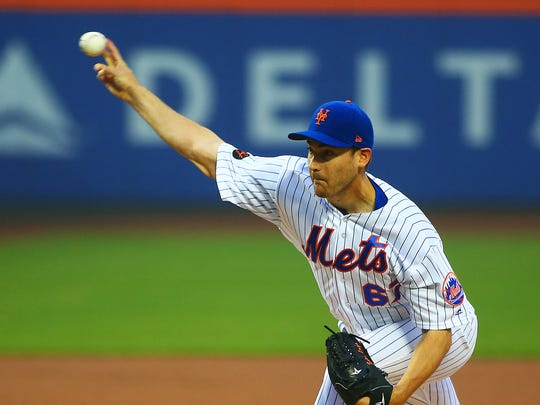 New York Mets starting pitcher Seth Lugo (67) pitches against the Chicago Cubs during the first inning at Citi Field.