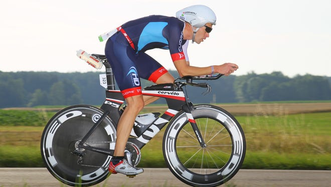 Heath Dotson, of Asheville, seen here competing in an Iron-distance triathlon in Germany this summer.