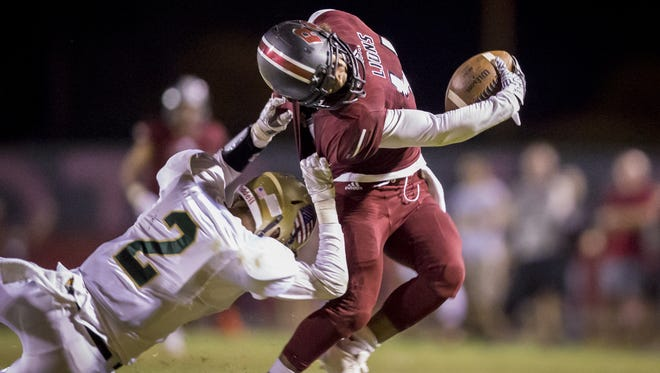 Cornerback Jeremy Mercier of Basha attempts to tackle Lance Lawson of Red Mountain in the second half of a high school football game at Red Mountain High School on Friday, September 9, 2016 in Mesa.