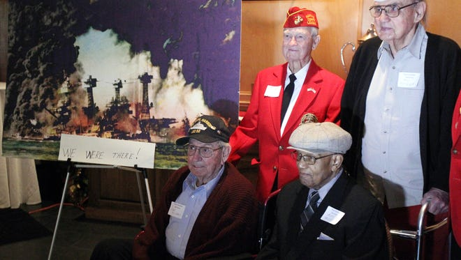 Bob Lowe, clockwise from top left, Bill Puissegur, Alex Taylor and Joe Richard, four area veterans who survived the attack at Pearl Harbor in 1941, pose for a photo as they come together with friends, family and other veterans for a reunion at the Petroleum Club Sunday, December 7, 2014, the 73rd anniversary of the attack, in Lafayette, La.