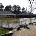 Water rises behind homes on Leeville Road in Petal during the recent flooding. Federal and state teams will be in the Pine Belt today to assess the damage.