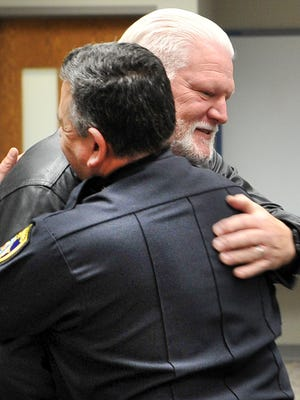 Retiring Wichita Falls police officer Paul Harper receives a hug from Police Chief Manuel Borrego at a ceremony honoring officer Harper's 36 years with WFPD Wednesday morning at the Wichita Falls Public Safety Training Center.