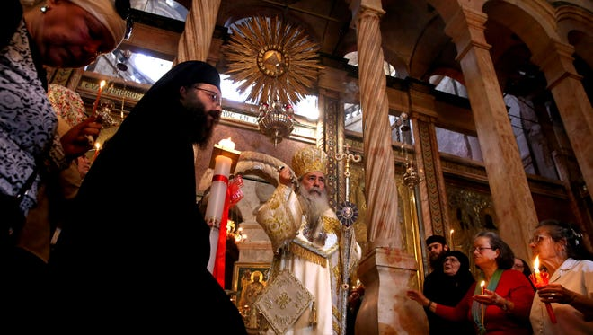 Greek Orthodox Patriarch of Jerusalem Theophilos III leads the Orthodox Easter Sunday Mass at the Church of the Holy Sepulchre in Jerusalem's Old City on May 1, 2016.