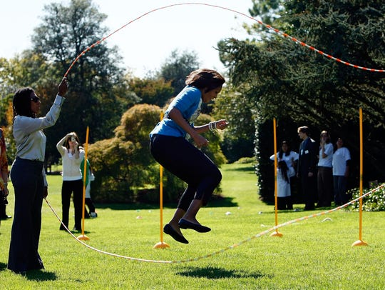 First lady Michelle Obama jump ropes Double Dutch