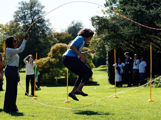 First lady Michelle Obama jump ropes Double Dutch  on the South Lawn of the White House in Washington during an event promoting exercise and healthy eating for children in 2009