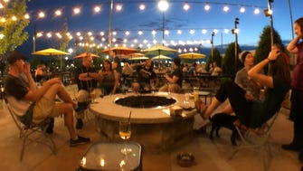 The Explorium Brewpub at Southridge in Greendale has an outdoor fire pit with comfy chairs around it as part of its patio dining.