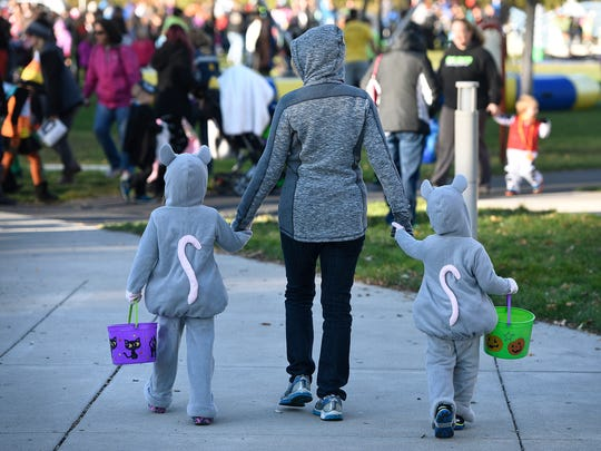 Children dressed as mice make their way through the