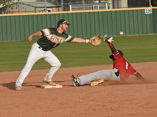 Parkway's Eric Williams is safe at second in their game against Captain Shreve Thursday.
