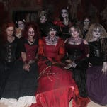 """Ghouls appear from every corner, as in this classic scene from 2014, in the """"Wisconsin Fear Grounds"""" haunted house attraction at the Waukesha Expo grounds."""