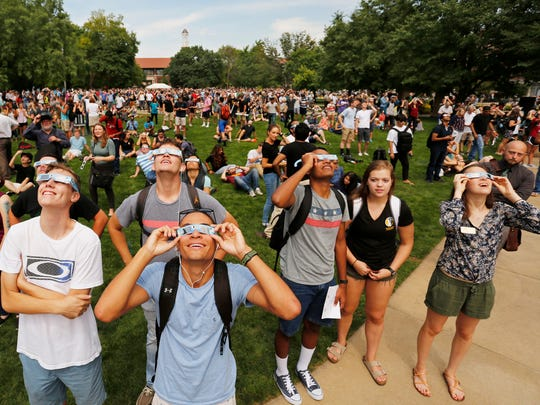 A  large crowd gathers in the Purdue Memorial Mall to observe the solar eclipse Monday, August 21, 2017, on the campus of Purdue University.
