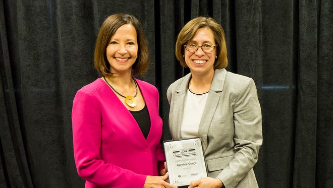 UW Colleges and UW-Extension Chancellor Cathy Sandeen, left, presents UW Fox-Valley Professor Caroline Geary with a Chancellor's Award for Excellence. The award was for Geary's outstanding contributions to a degree reimagining project in the UW Colleges.