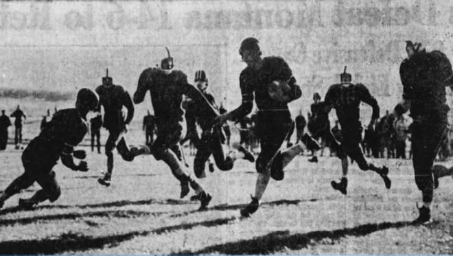 Charlie Mathews of Simms, far left, dives to make a key block for teammate Mel Knapstad on Nov. 8, 1958. The Tigers defeated St. Leo's for the Northern C Six-Man title.