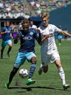 Seattle Sounders' Victor Mansaray (left) fends off a challenge from Eintracht Frankfurt's Noel Knothe in the second half of Saturday's game in Seattle.