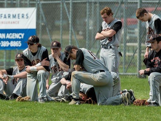The Marshfield High School baseball team reacts Saturday