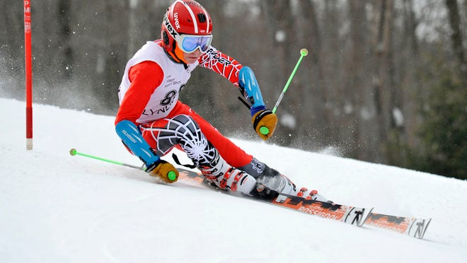 Champlain Valley's Nate Coffin competes in the first of two giant slalom runs at Lyndon's annual ski carnival at Burke Mountain on Friday.
