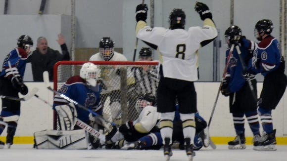 Riku Robins (7) and his Clarkstown teammates wait for a signal on the game-winning goal Sunday. The junior forward snapped a 2-2 tie with 7:15 to play in a Section 1 Division I opening-round game.
