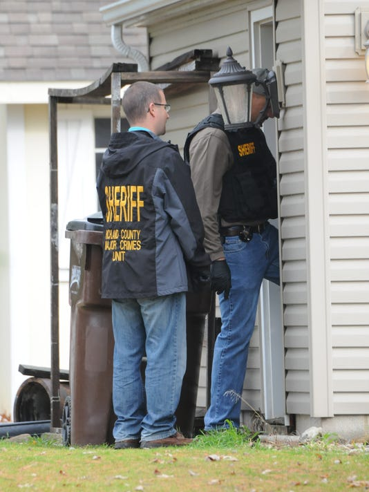 Key Bank robbed, family held hostage