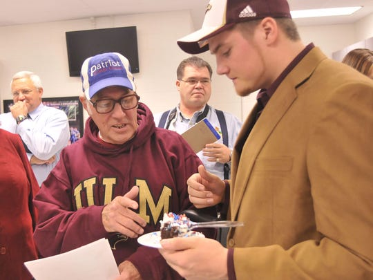2-4-09, online Pace Signing Day 5 of 6  Torby Giles, left, congratulates his grandson Ben Giles, right, on offer to play football at the University of Louisiana at Monroe.