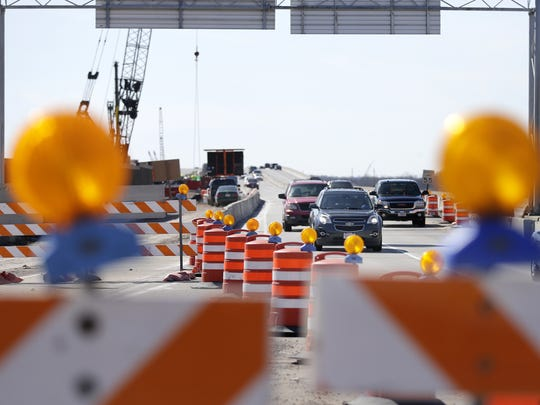 Traffic flows Tuesday amid construction along State 441 in Menasha. The state Department of Transportation held a press conference near 441 to highlight the need for safe driving practices in work zones.