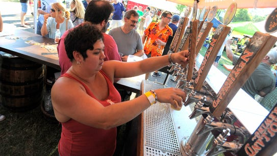 New Holland Brewing's Liz Aker pours a beer during