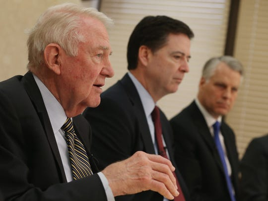 Former U.S. attorney general Edwin Meese, left,  speaks while flanked by FBI Director James Comey and former congressman Timothy Roemer, D-Ind., during a news conference at FBI headquarters held to discuss the recent review of the 9/11 Commission Report.