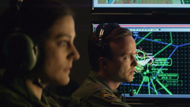 "Phoebe Fox (left) stars as Carrie Gershon and Aaron Paul (right) stars as Steve Watts, iron operators in director Gavin Hood's ""Eye in the sky."""