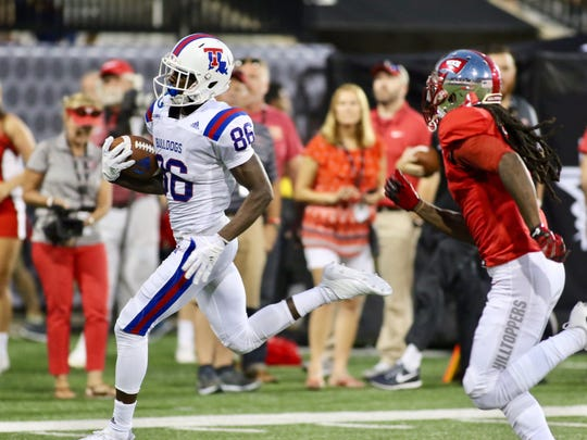 Louisiana Tech redshirt sophomore wide receiver Rhashid Bonnette (86) runs the ball against Western Kentucky's defense Saturday, Sept. 16, 2017 at Houchens-Smith Stadium.